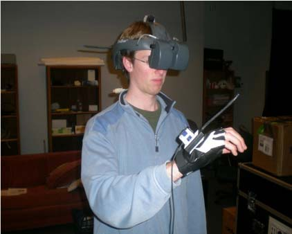 Using a 3D UI while wearing a head-mounted display. The TV in the background shows the image displayed in the HMD.