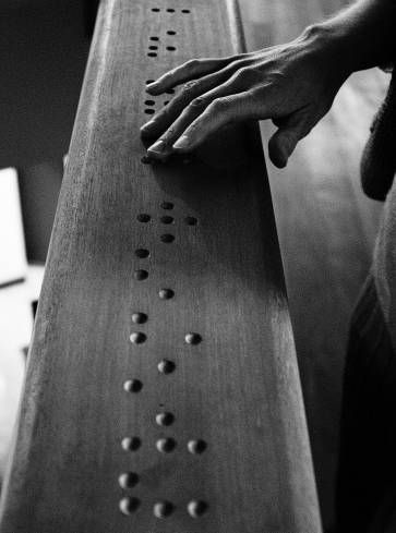 "Wood-carved braille code of the word 'premier' (French for ""first"")"