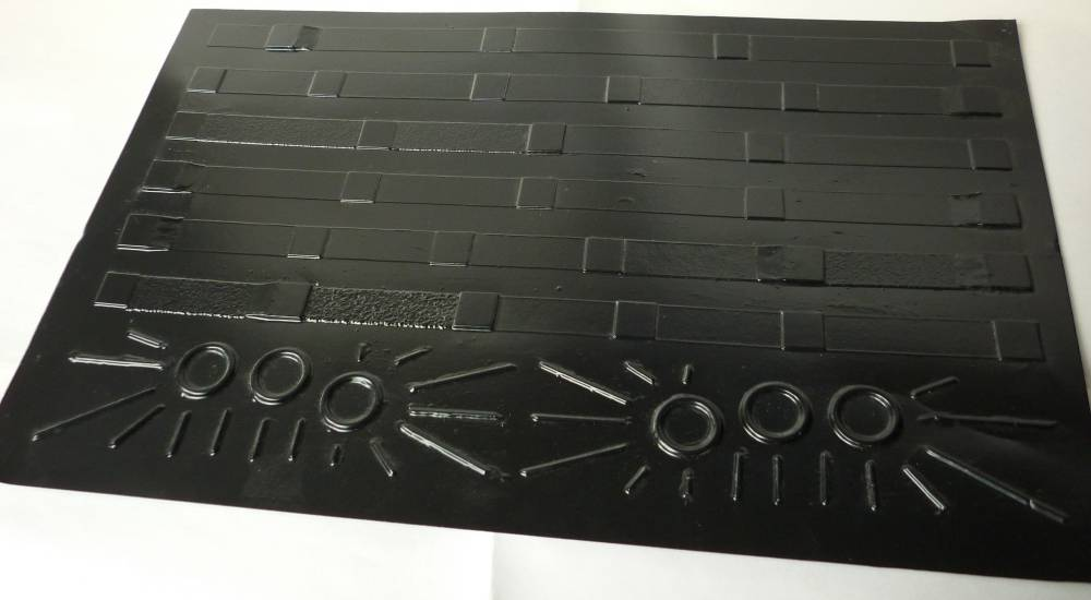 A tactile overlay for conveying the structural information from a page of music notation. Made from vacuum-formed pvc, the overlay displays key elements such as bars, lines to a page, repeat marks etc