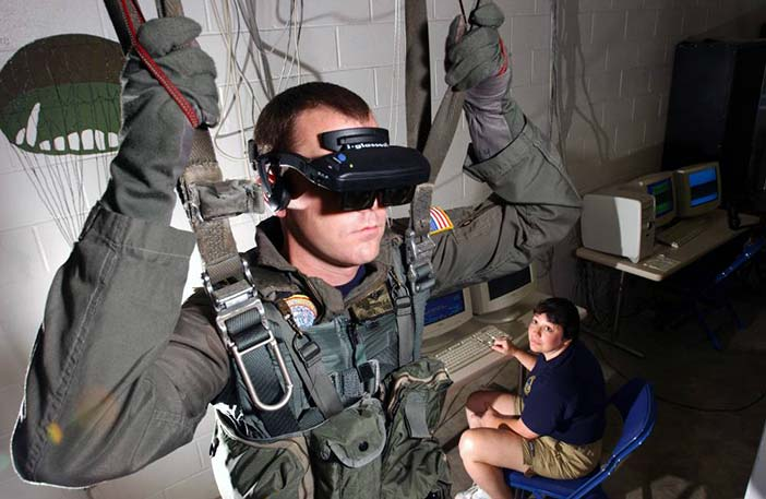 Virtual Reality (VR) parachute trainer. Students wear the VR glasses while suspended in a parachute harness, and then learn to control their movements through a series of computer-simulated scenarios.