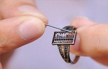 "Here is a ""computer"" (an abacus) and since it is a piece of jewelry (a ring), it is wearable. Such devices have existed for centuries, but do not successfully embody Humanistic Intel"