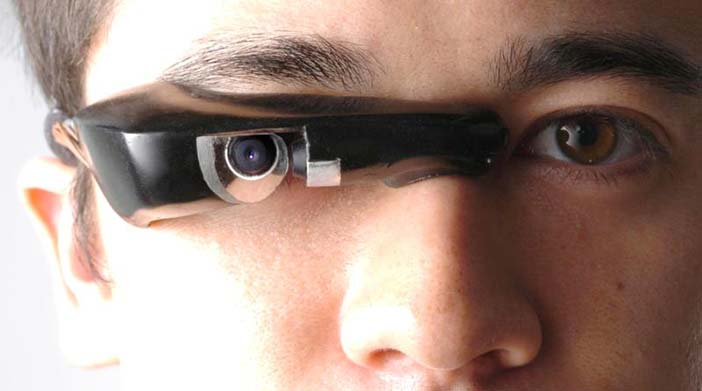 Mann's 'GlassEye™' invention, also known as an EyeTap device, is an input+output device that can connect to a smart phone or other body-borne computer, wirelessly, or by a con
