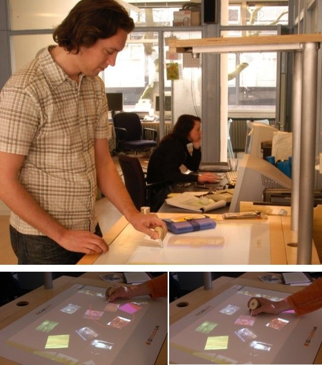 the final prototype cabinet consisted of a table display on which images could be grouped and arranged and a means for importing digital and physical